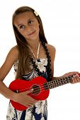 Adorable Tan Girl Playing A Red Ukulele In Tropical Dress