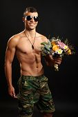 Young soldier holds bouquet