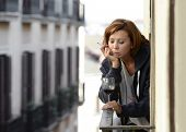 Woman Suffering Depression And Stress Outdoors Drinking Wine At The Balcony