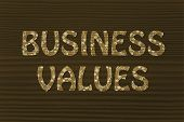 Business Values Writing With Glowing Gearwheels Pattern