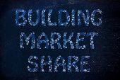 Building Market Share Writing With Glowing Gearwheels Pattern