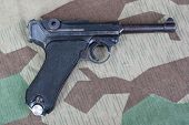 P08 Parabellum Handgun On Camouflaged Background