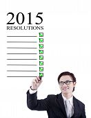 Smiling Businessman Writes Resolution
