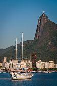 Tourist boat in Rio de Janeiro harbor with Corcovado Mountain