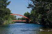 Red Bridge Extending Over The River