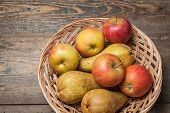 image of indian apple  - Pumpkins apples pears tomatos and straw on a wooden plate - JPG