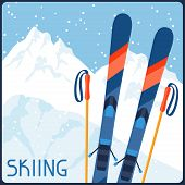 Skiing equipment on background of mountain winter landscape.