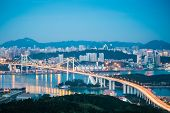 Aerial View Of Xiamen Haicang Bridge In Nightfall
