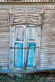 Vintage window of an old wooden house in Russia