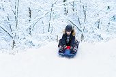 picture of sleigh ride  - Happy Laughing Child Enjoying A Sleigh Ride In A Snowy Winter Park - JPG