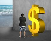 foto of shackles  - business man being shackled with gold dollar on concrete wall and sea background - JPG