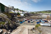 boats in the harbourCoverack Cornwall with  at low tide in the late summer sunshine