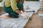 Worker Puts The Blocks On The Sidewalk