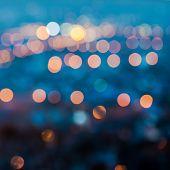 City Blurring Lights Abstract Circular Bokeh On Blue Background, Closeup