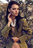 Beautiful Woman With Dark Hair In Elegant Jacket With Accessory