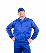 Worker with arms on waist.