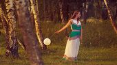 Woman With White Balloon In Forest