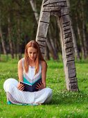 Woman Reading A Book In Nature