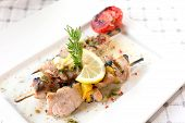 stock photo of swordfish  - Swordfish fillet grilled with souse lemon and rosemary - JPG