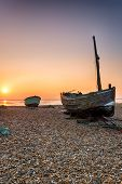 Sunrise Over Fishing Boats On A Beach