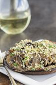 pic of portobello mushroom  - Portobello mushroom caps filled with shallots and cremini mushroom in a white wine cream sauce broiled with a parmesan chive and cilantro panko topping - JPG