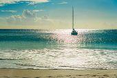 Yacht At Tropical Beach At Sunset. Anse Georgette, Praslin Island, Seychelles