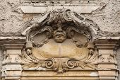 Funny mascaron on the Art Nouveau building in Prague, Czech Republic.