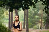 Healthy Fitness Sporty Woman Running Early In The Morning In Forest