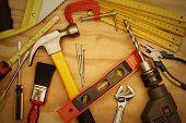Assorted work tools on wood