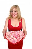 stock photo of home is where your heart is  - a lady holds a big heart shaped tray of valentine day heart shaped cookies - JPG