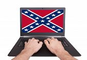 Man Working On Laptop, Confederate Flag