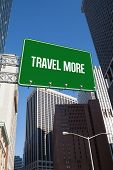 The word travel more and green billboard sign against new york