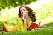 Beautiful Student Reading And Relaxing In Park