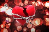 Locked heart against twinkling red and orange lights