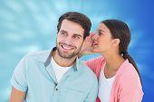 Brunette whispering secret to her boyfriend against valentines heart design