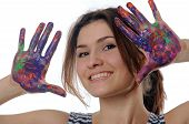 Girl Shows Her Hands Painted In Colorful Paint