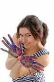 Painter Shows Her Hands Painted In Colorful Paint And She Folded Them Like Wings