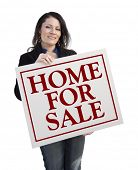 Hispanic Woman Holding Home For Sale Real Estate Sign Isolated On White.