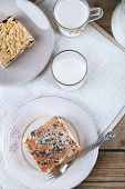 Homemade pies with jam and glass of milk on wooden planks background