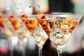 Four Martini cocktails