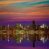picture of nightfall  - Manhattan New York skyline at sunset dusk from East River NYC USA - JPG
