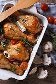 Baked Chicken Drumsticks With Vegetables Closeup. Vertical Top View