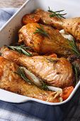 Chicken Legs With Rosemary In A Baking Dish Close-up  Vertical