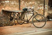 Agra, India - Circa Nov 2012: An Improvised Tricycle With A Wooden Cargo Pallet, Parked