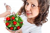 pic of youg  - Youg woman eating healthy salad isolated on white background - JPG
