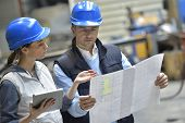 picture of mechanical engineering  - Engineers in mechanical factory reading instructions - JPG
