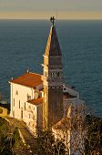 Saint George church and bell tower at city of Piran in Istria