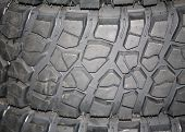 stock photo of four-wheel  - Four wheel drive tire stack as a background - JPG