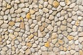 Natural stone wall of beige and yellow stones