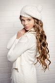 picture of beret  - Cute teenager girl with beautiful long curly hair wears white knitted jersey and beret - JPG